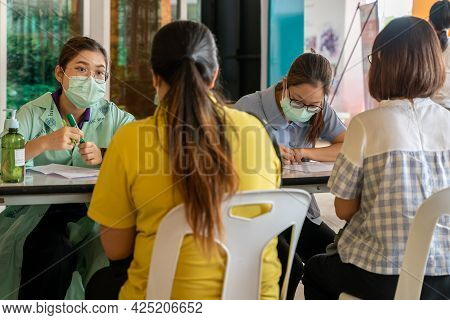 Chiang Mai, Thailand - 28 June 2021 - Thai Nurses Check People Information Before Sending Them In To