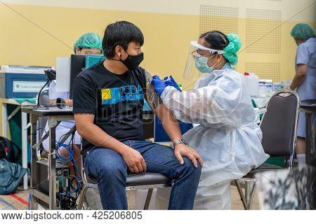 Chiang Mai, Thailand - 28 June 2021 - A Thai Man Get His Covid-19 Vaccine In Chiang Mai, Thailand