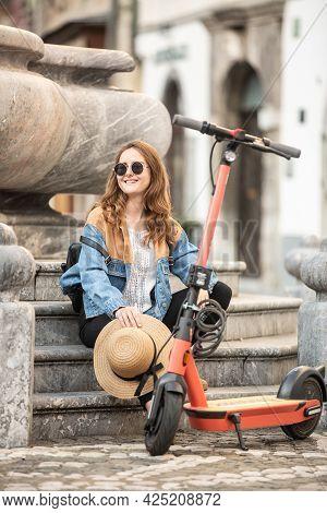 Traveler Exploring Ljubljanas Old Medieval Historical City On Environmentally Friendly Electric Scoo