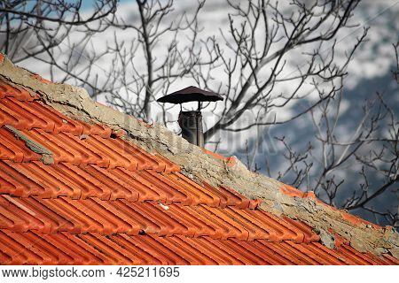 A Chimney On A Traditional Lebanese Shingles Rooftop During A Snowy Winter.