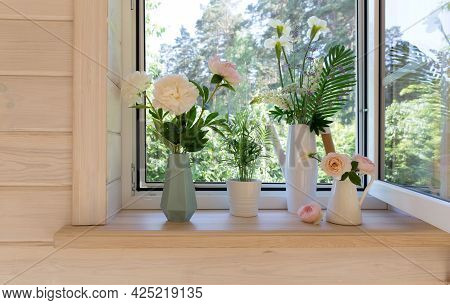 White Window With Mosquito Net In A Rustic Wooden House Overlooking The Garden. Bouquet Of White Iri