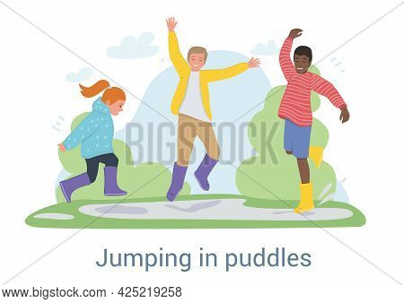 Three Joyful Young Kids In Gumboots Playing Together Jumping In Puddles Outdoors In The Park After R