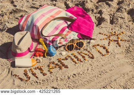 Inscription Vitamin D With Shape Of Sun, Accessories For Relax And Childrens Playing On Sand At Beac