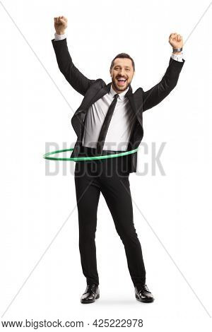 Full length portrait of a happy businessman spinning a hula hoop isolated on white background