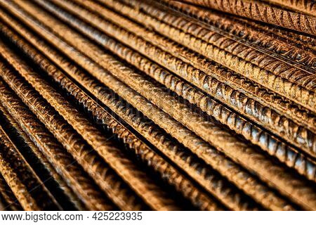 Rusty Reinforced Steel Bars In A Stack With Contrast