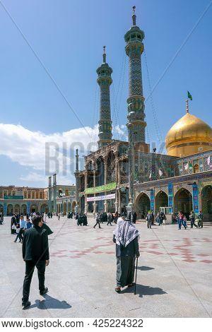 Qom, Iran - 04.20.2019: Believers Walking Under Minarets In The Courtyard Of Fatima Masumeh Shrine.
