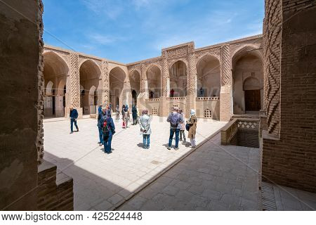 Yazd, Iran - 13.04.2019: People Walking In The Courtyard Of The Historical Jameh Mosque Of Naein, Ya