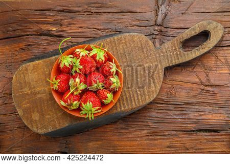 Ripe Strawberries In A Plate On A Wooden Table On A Wooden Board. Horizontal Photo