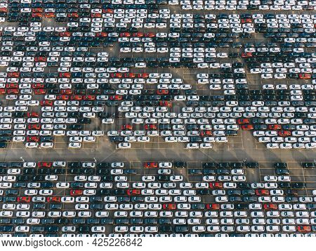 Giant Car Parking Aerial View, Colorful Cars Are Standing In Straight Rows On The Asphalt Parking Lo