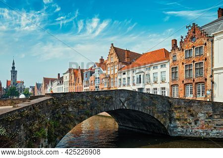 Bruges typical Belgian cityscape Europe tourism concept - bridge over canal and old Flemish houses. Brugge, Belgium