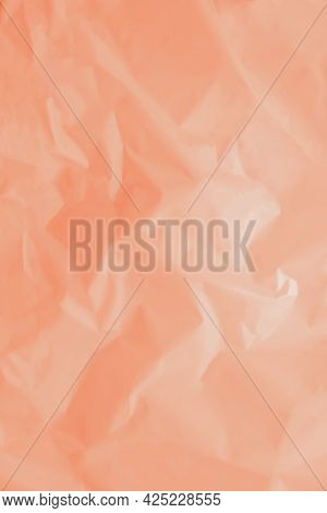 Paper Crumpled Background Of Tangerine, Peach Color. Vertical Background