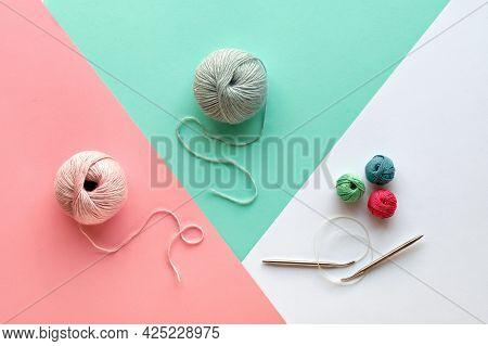 Wool Yarn, Cotton Balls And Knitting Needles, Creative Knitting Hobby. Panoramic Background In Pink,