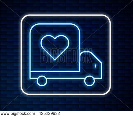 Glowing Neon Line Delivery Truck With Heart Icon Isolated On Brick Wall Background. Love Delivery Tr