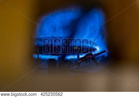 Pilot Light Auto Igniter Inside A Hot Water Heater With Flames