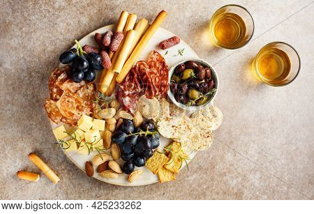 Antipasto Plate With Cheese, Wine, Grapes, Bread Sticks, Salami, Olives And Nuts. Appetizers. Top Vi