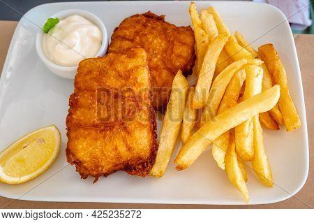 Fried Fish In Breadcrumbs Served In A Greek Tavern.