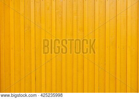 Yellow Wooden Tabby Textured Wall Background. Wall Of The Wooden House Is Painted Yellow. Painted Ve