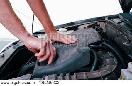 An Auto Mechanic Opens The Oil Filler Plug To Change The Oil. Auto Mechanic Working On Car Engine In