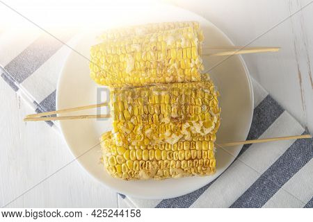 Recipe Homemade Cooking. Mexican Elote Corn On Sticks Sprinkled With Cheese Parmesan And Spices Chil