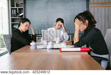 Group Young Asian Business People Obviously Bored With What's Happening In The Meeting He's Attendin