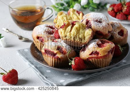 Homemade Strawberry Muffins Sprinkled With Powdered Sugar On A Light Gray Background. Close-up