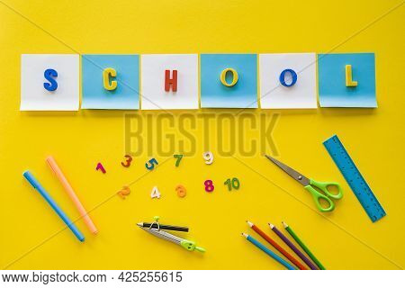 School Concept. Top View Of School Supplies On Yellow Background With Empty Space For Text. Flat Lay