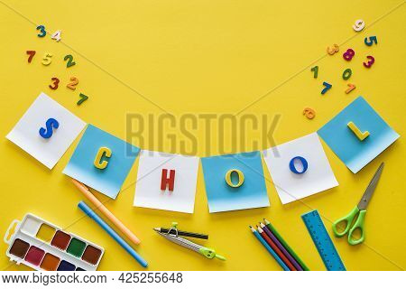 Back To School Concept.top View Of School Supplies On Yellow Background With Empty Space For Text. F