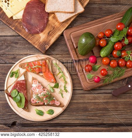 Healthy Sandwiches On Wooden Plate  On Old Wooden Table