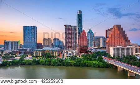 Austin, Texas, USA downtown city skyline on the Colorado River at dusk.