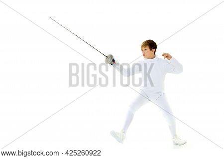 Fencer Boy Practicing Effective Technique. Portrait Of Handsome Teenage Boy Fencing Player Wearing W