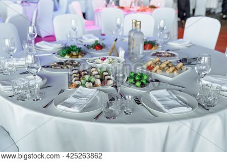 Table Setting For A Banquet Or Celebration. Empty Wine Glasses For Spirits, Champagne And Juice. Set