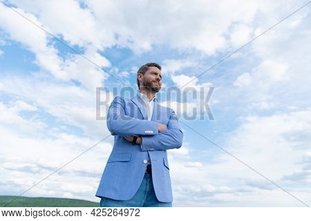 Handsome Mature Man Businessman In Formal Suit Check Time On Wristwatch On Sky Background, Charisma