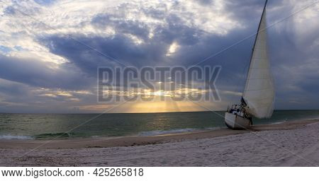 Sunset Over Shipwreck On The Coast Of Clam Pass In Naples
