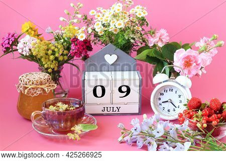 Calendar For July 9 : The Name Of The Month Of July In English, Cubes With The Numbers 0 And 9, A Cu