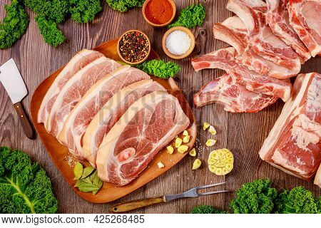 Cut Pork Meat Chop Bone In And Pork Belly On Wooden Table..
