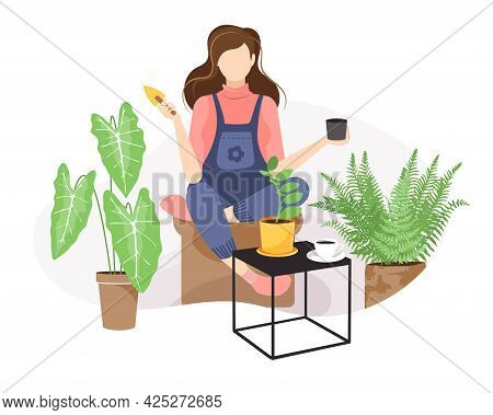 Woman In Overalls Sits On An Ottoman, Transplants A Indoor Plant And Holds A Scoop In Her Hand. Flor