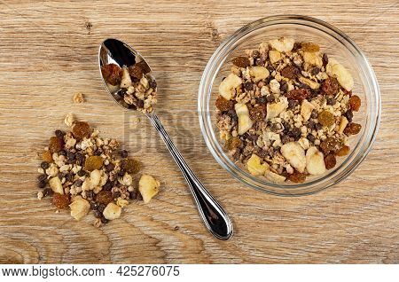 Heap Of Muesli, Muesli In Spoon, Transparent Glass Bowl Of Granola With Banana And Chocolate On Brow