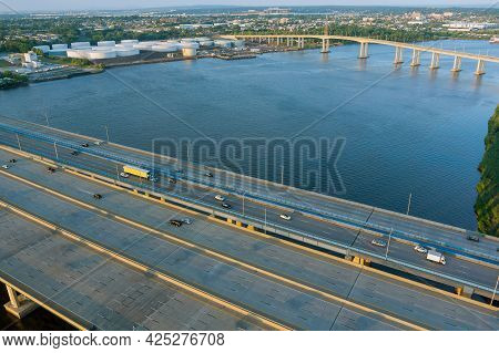 Traffic On The Motorway In The Road Alfred E. Driscoll Bridge Over The Water Across Raritan River Wi