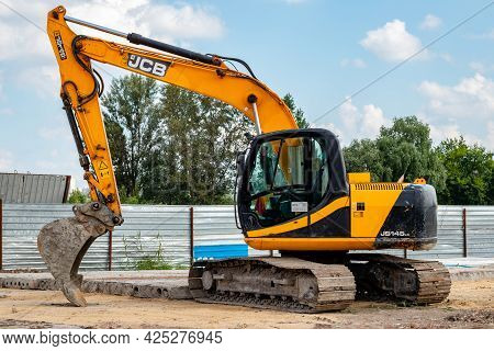The Dirty Yellow Jcb Crawler Excavator With Bucket At The Construction Site. Illustrative Editorial