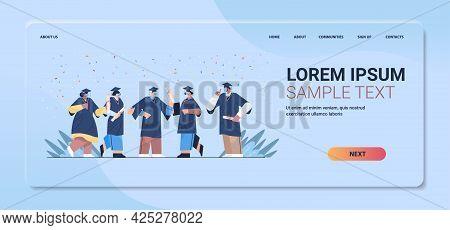 Graduated Students In Masks Happy Graduates Celebrating Academic Diploma Degree Education University