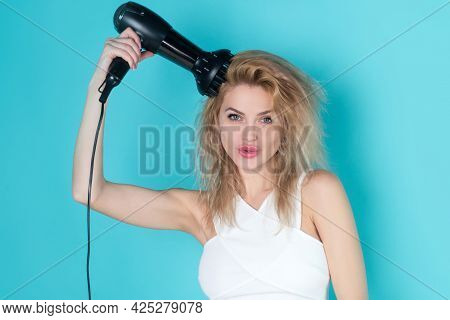 Woman Blow Drying Her Hair. Young Girl With Drying Hair With Hair Dry. Health Hair And Beauty Concep