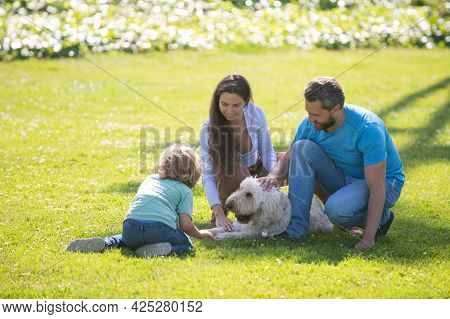 Happy Family On Summer Walk. Father Mother And Child Walking In The Park And Enjoying The Beautiful