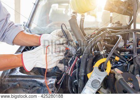 Auto Mechanic Working On Car Engine In Mechanics Garage, Repair And Maintenance Service