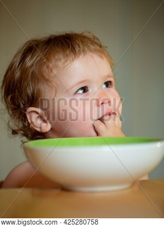 Happy Baby Eating Himself With A Spoon. Lick Tasty Fingers.