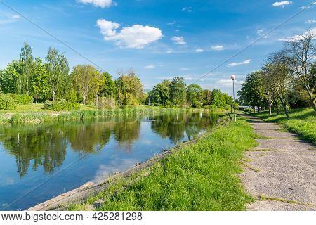 Gwda River In City Center Of Pila, Poland.