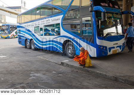 Bangkok, Thailand - December 14, 2018: Ederly Buddhist Monk Waits To Board The Intercity Bus On The
