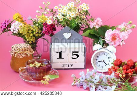 Calendar For July 15 : The Name Of The Month Of July In English, Cubes With The Number 15, A Cup Of