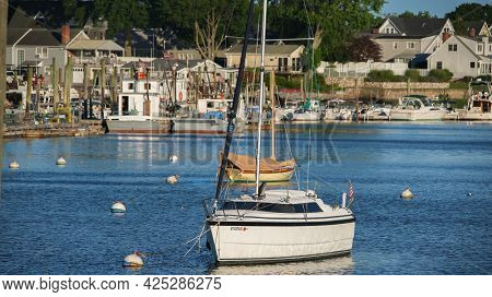 NORWALK, CT, USA - JUNE, 24, 2021: Evening lights on boats and view from Veterans Memorial Park and Marina