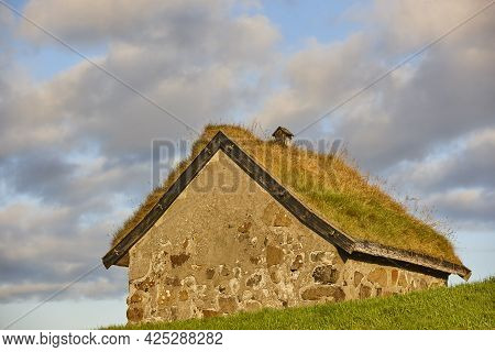 Traditional Stone House With Turf Roof In Faroe Islands. Denmark