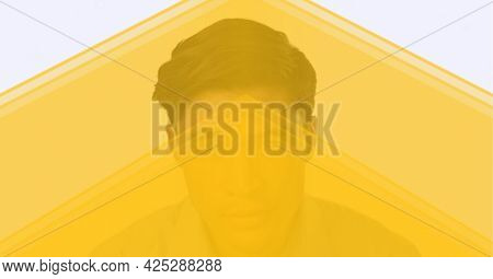 Yellow technology background over portrait of man against white background. business and modern technology concept